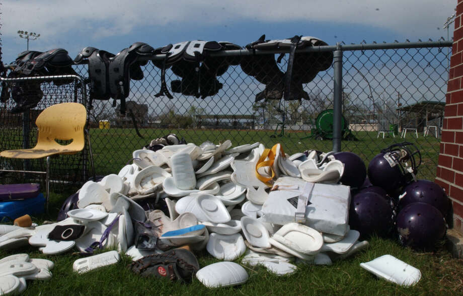 Sports equipment, including pads, helmets gloves and bases, drys in the sun at the Sabine Pass athletic complex Saturday.  Photo/Jennifer Reynolds