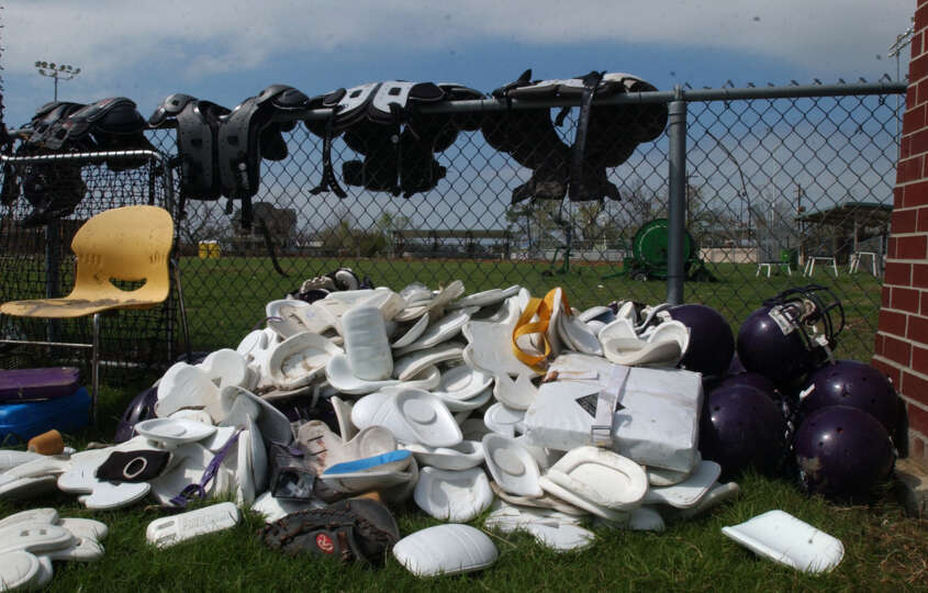 Sports equipment, including pads, helmets gloves and bases, drys in the sun at the Sabine Pass athle