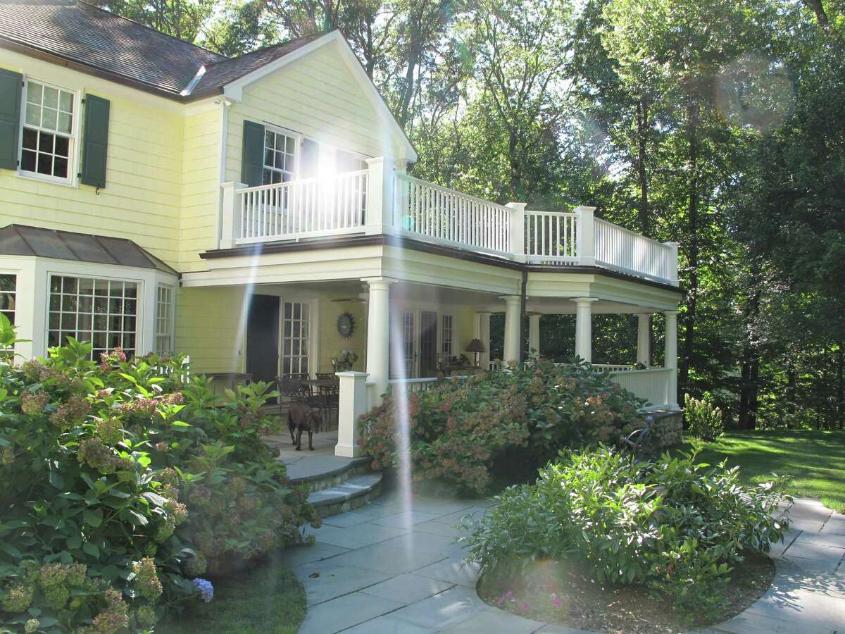 The Howe family's porch on Alan Lane was added in 2002 after the family rented a vacation home with a porch.