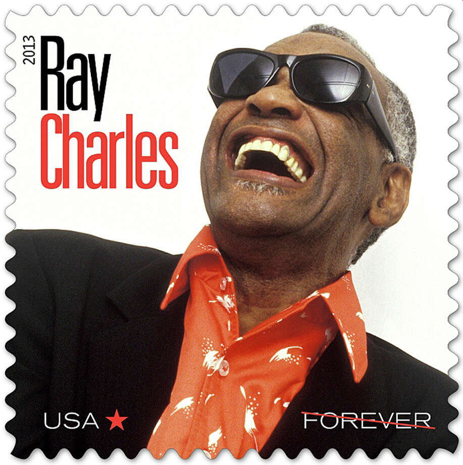 In this undated photo provided by the The U.S. Postal Service, a new Postal Service stamp honoring musician Ray Charles is shown. The stamp is part of the Music Icons series of stamps. The stamp is to be unveiled in Atlanta. (AP Photo/The U.S. Postal Service) ORG XMIT: AX101 / The U.S. Postal Service