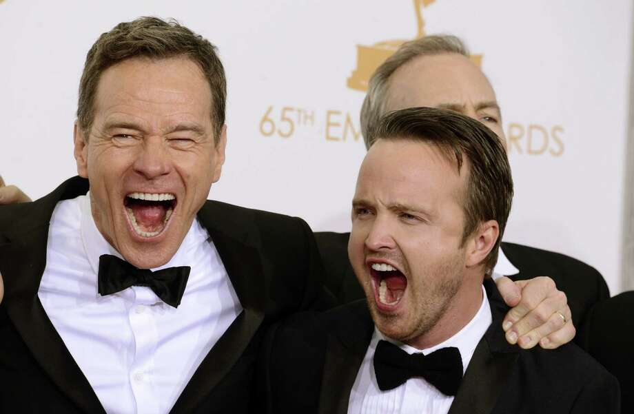 """Bryan Cranston, left, and Aaron Paul, winners of the best drama series award for """"Breaking Bad"""" pose backstage at the 65th Primetime Emmy Awards at Nokia Theatre on Sunday Sept. 22, 2013, in Los Angeles.  (Photo by Dan Steinberg/Invision/AP) ORG XMIT: CAAK154 Photo: Dan Steinberg / Invision"""