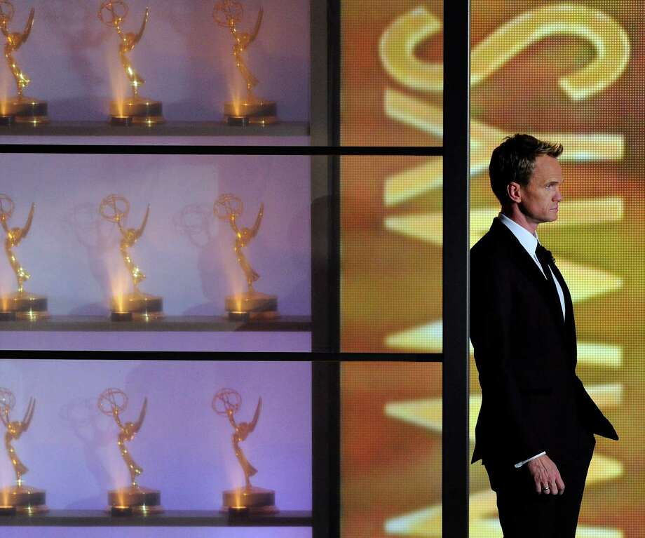 Host Neil Patrick Harris appears on stage at the 65th Primetime Emmy Awards at Nokia Theatre on Sunday Sept. 22, 2013, in Los Angeles.  (Photo by Chris Pizzello/Invision/AP) ORG XMIT: CAMG503 Photo: Chris Pizzello / Invision