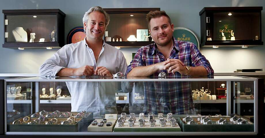 Scott Kaplan, above left, and Jacek Kozubek, owners of H.Q. Milton, scour the world for vintage Rolex watches that attract collectors to their Mission District dealership, founded in 2008. Photo: Russell Yip, The Chronicle
