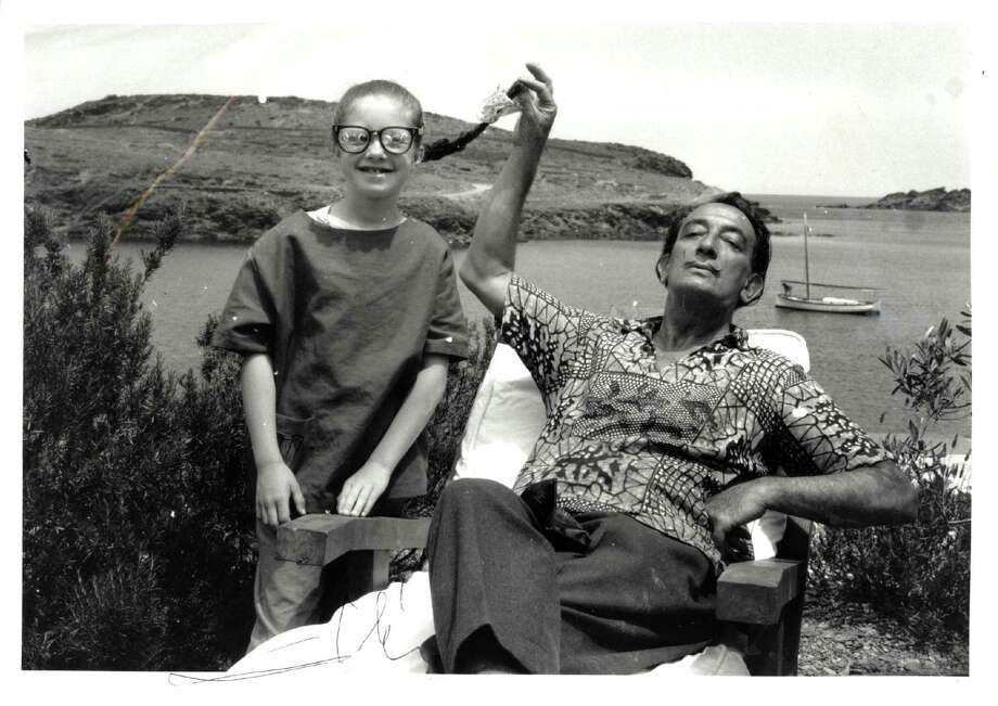 A young Christine Argillet clowns around with Salvador Dali, a close friend and associate of her father, the publisher Pierre Argillet. Photo: Argillet Collection