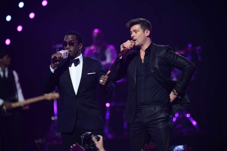 "Sean ""Diddy"" Combs, left, and Robin Thicke perform at IHeartRadio Music Festival, day 1, on Friday, Sept, 20, 2013 in Las Vegas. (Photo by Al Powers/Invision/AP) Photo: Powers Imagery, Associated Press"