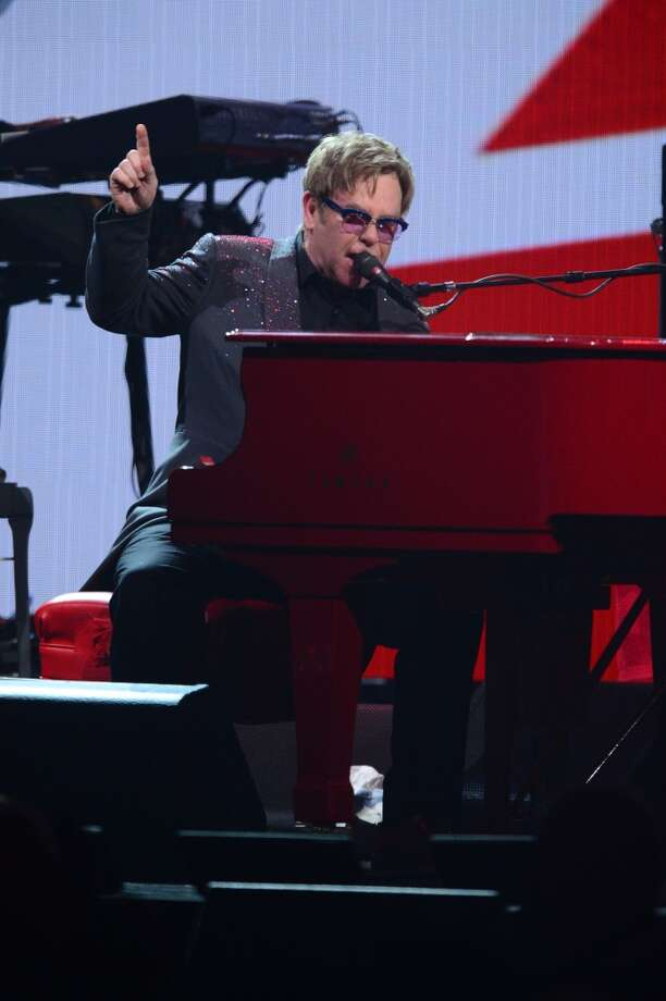 This Sept. 20, 2013 photo shows Elton John performing at the iHeartRadio Music Festival in Las Vegas, Nev. (Photo by Al Powers/Powers Imagery/Invision/AP) Photo: Powers Imagery, Associated Press