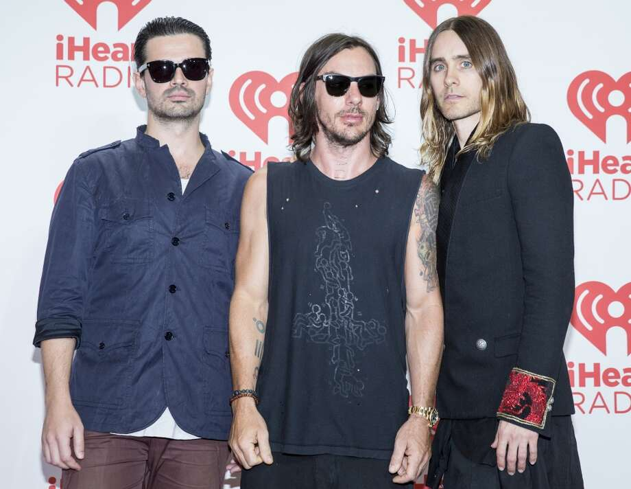 Shannon Leto left,  Tomo Milicevic and Jared Leto of Thirty Seconds to Mars, arrive at the iHeartRadio Music Festival, Saturday Sept. 21st, 2013, at the MGM Grand Garden Arena in Las Vegas. (Photo by Eric Jamison/Invision/AP Images) Photo: Eric Jamison, Associated Press