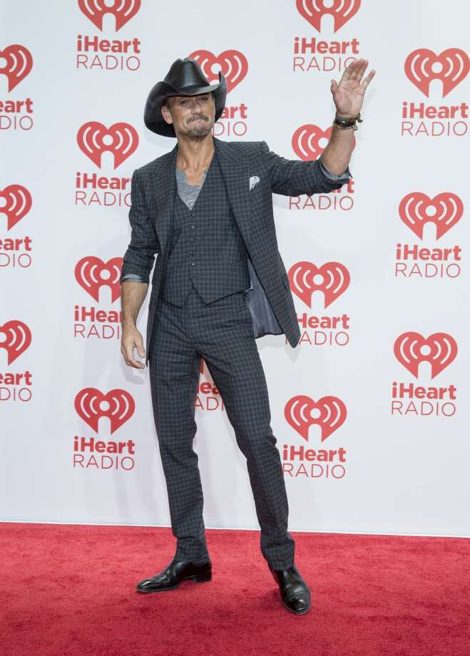 Tim McGraw arrives at the iHeartRadio Music Festival, Saturday Sept. 21st, 2013, at the MGM Grand Garden Arena in Las Vegas. (Photo by Eric Jamison/Invision/AP Images) Photo: Eric Jamison, Associated Press