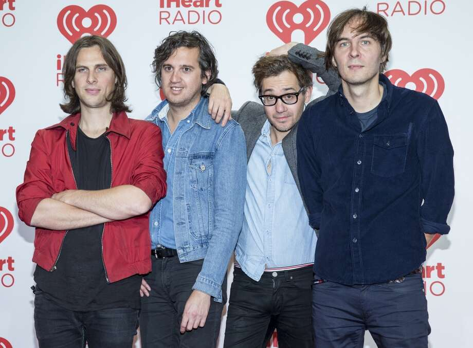 Deck d'Arcy, left,  Christian Mazzalai, Laurent Brancowitz and Thomas Mars of Phoenix, arrive at the iHeartRadio Music Festival, Saturday Sept. 21st, 2013, at the MGM Grand Garden Arena in Las Vegas. (Photo by Eric Jamison/Invision/AP Images) Photo: Eric Jamison, Associated Press