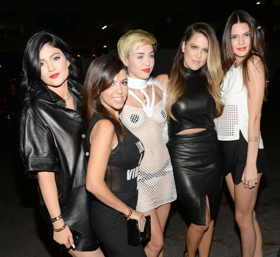 LAS VEGAS, NV - SEPTEMBER 21:  (L-R) Kylie Jenner, Kourtney Kardashian, Miley Cyrus, Khloe Kardashian and Kendall Jenner attend the iHeartRadio Music Festival at the MGM Grand Garden Arena on September 21, 2013 in Las Vegas, Nevada.  (Photo by Jason Kempin/Getty Images for Clear Channel) Photo: Jason Kempin, Getty Images For Clear Channel