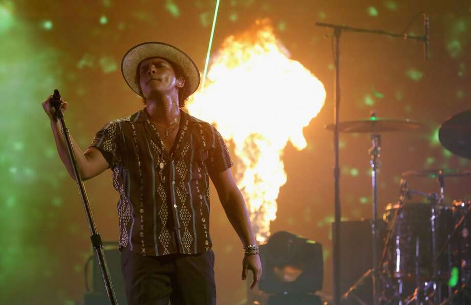 Recording artist Bruno Mars performs onstage during the iHeartRadio Music Festival at the MGM Grand Garden Arena on September 21, 2013 in Las Vegas, Nevada.  (Photo by Christopher Polk/Getty Images for Clear Channel) Photo: Christopher Polk, Getty Images For Clear Channel