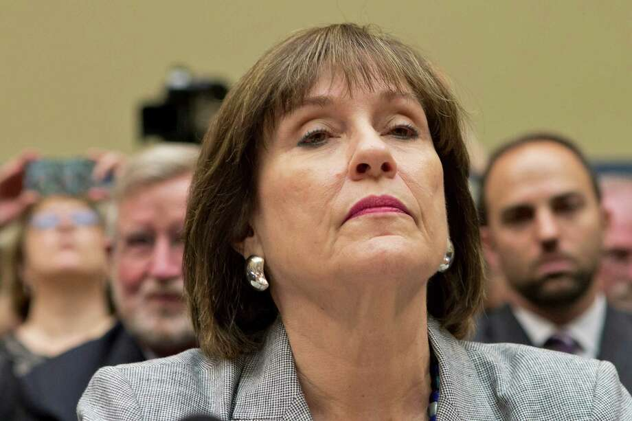 FILE - In this May 22, 2013 file photo, Lois Lerner, head of the IRS unit that decides whether to grant tax-exempt status to groups, listens on Capitol Hill in Washington. Lerner, the official at the center of the agency's tea party scandal is retiring. Lerner headed the IRS division that handles applications for tax-exempt status when she was placed on paid leave in May. While she was in charge, the agency acknowledged that agents improperly targeted tea party groups for extra scrutiny when they applied for tax-exempt status from 2010 to 2012.  (AP Photo/J. Scott Applewhite, File) Photo: J. Scott Applewhite, STF / AP