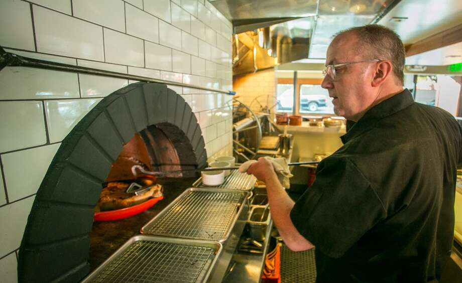 Chef Bruce Hill cooks the Wood Oven Chicken at Fog City in San Francisco. Photo: John Storey, Special To The Chronicle