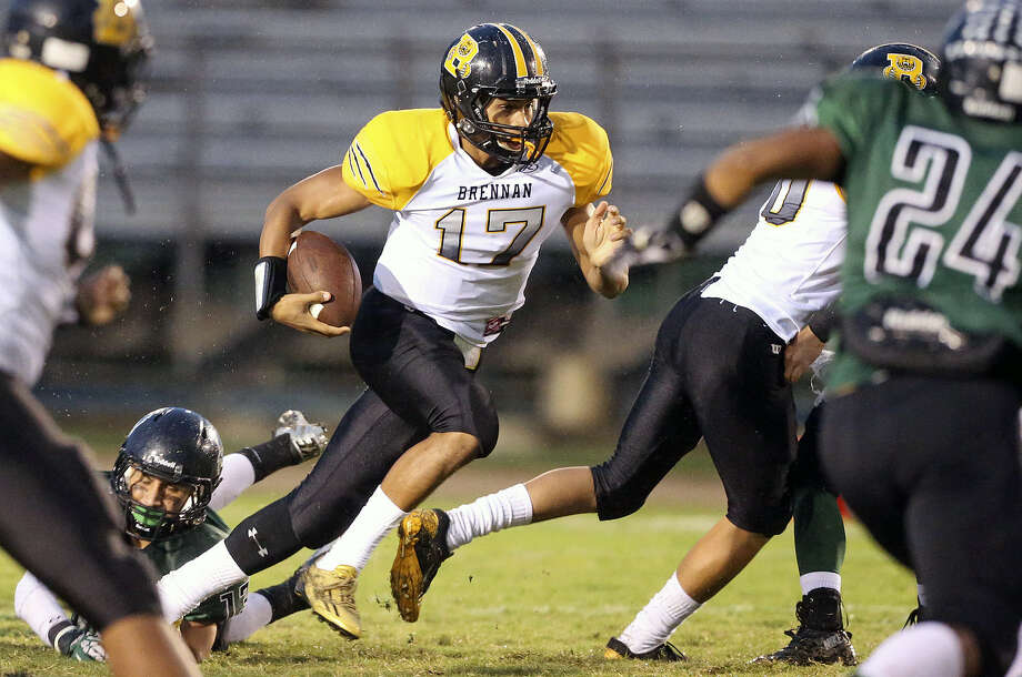 Bear quarterback Da'Shawn Key takes a keeper up the middle for the Bears as Southwest hosts Brennan at Dragon Stadium last Friday. Photo: Tom Reel / San Antonio Express-News