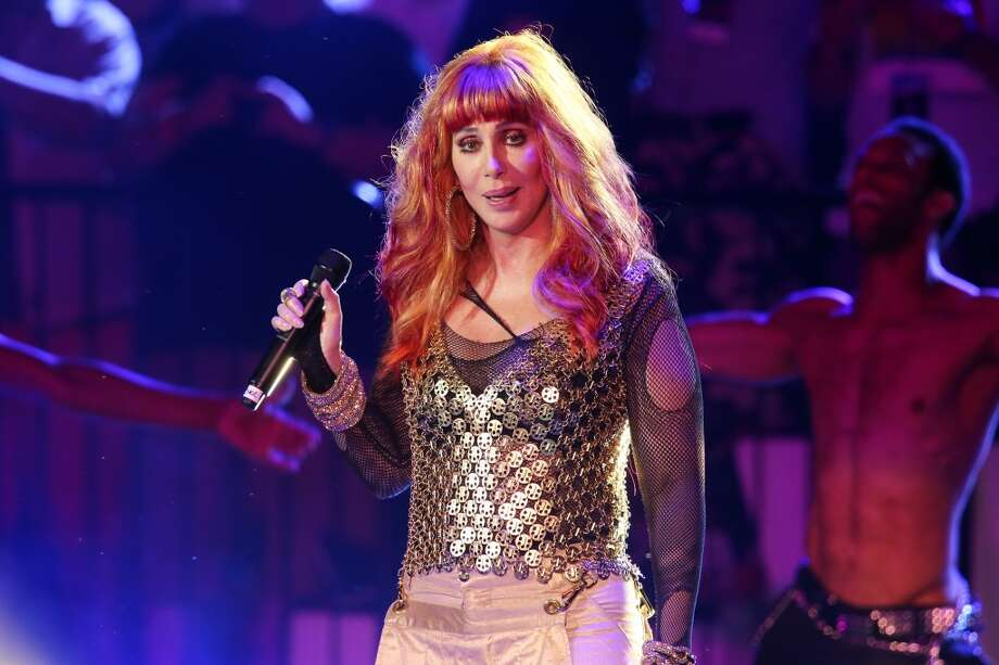 "NEW YORK, NY - JUNE 30:  Cher performs on stage as part of the 27th ""Dance on the Pier"" party during NYC Pride 2013 on June 30, 2013 in New York City.  (Photo by Neilson Barnard/Getty Images) Photo: Neilson Barnard, Getty Images"