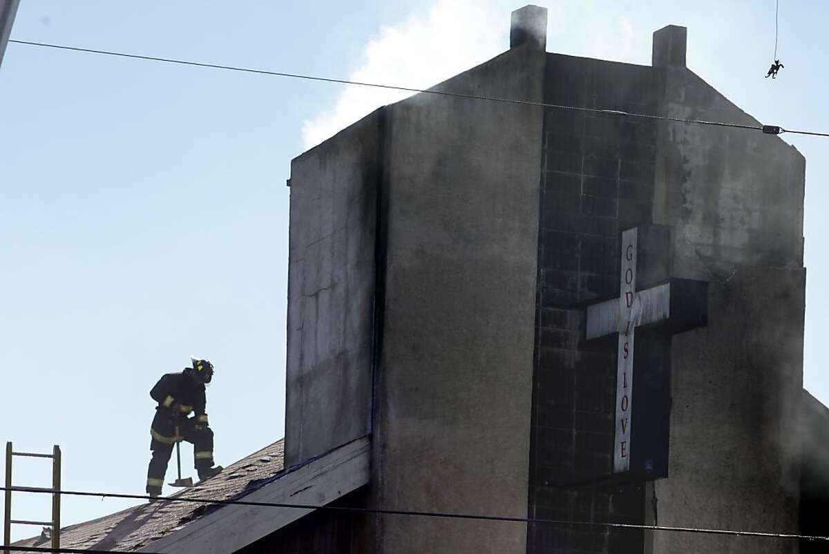 Firemen from the Oakland Station 20 fight the fire which broke out at the Zion's First Church of God in Christ, Monday September 23, 2013, in Oakland, Calif.