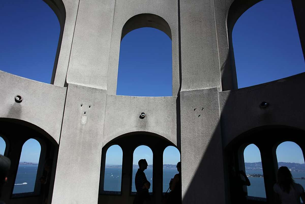 Visitors to Coit Tower are seen on the top floor on September 18, 2013 in the Telegraph Hill area of San Francisco, Calif.