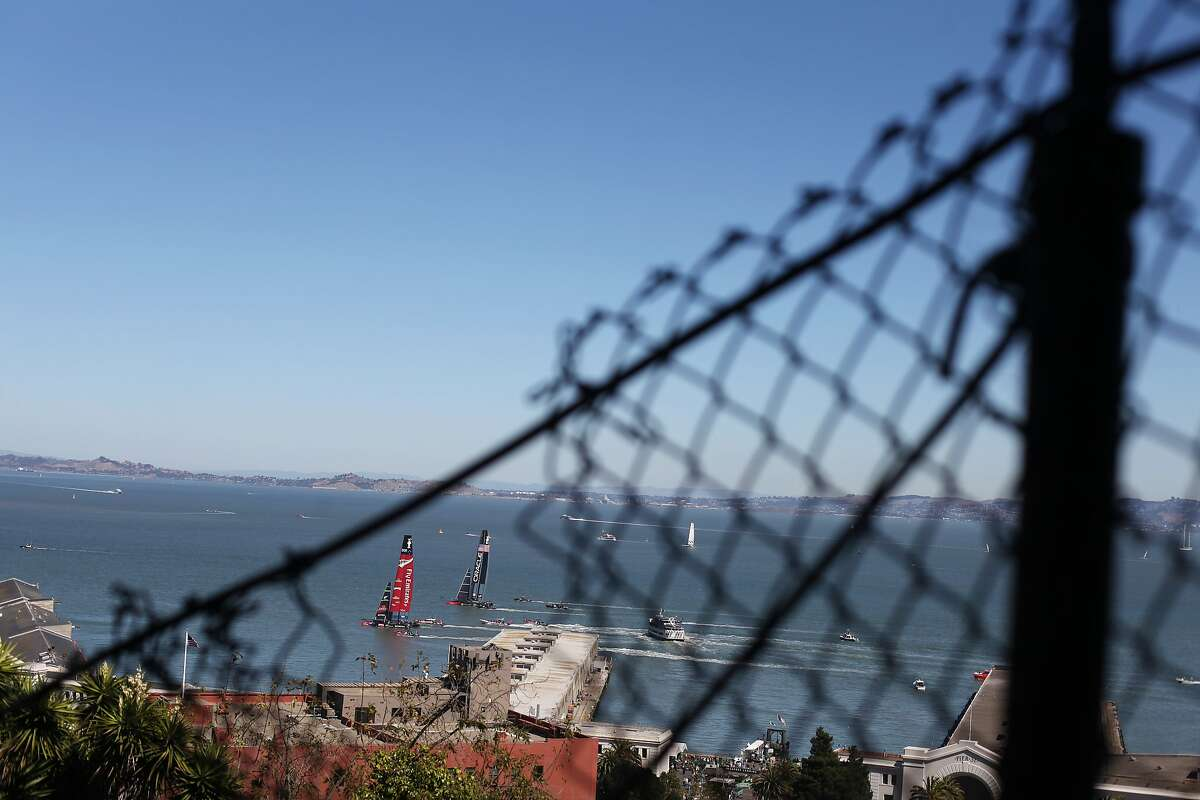 America's Cup yachts are seen through a fence on the north side of Pioneer Park near Telegraph Boulevard on September 18, 2013 in the Telegraph Hill area of San Francisco, Calif.