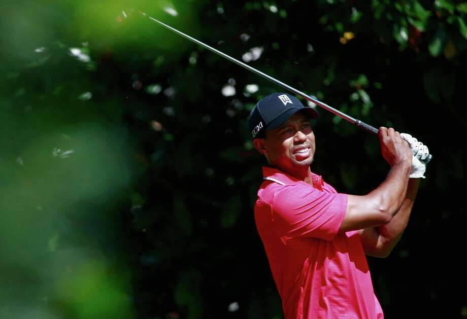 ATLANTA, GA - SEPTEMBER 22:  Tiger Woods watches his tee shot on the fourth hole during the final round of the TOUR Championship by Coca-Cola at East Lake Golf Club on September 22, 2013 in Atlanta, Georgia.  (Photo by Sam Greenwood/Getty Images) ORG XMIT: 159810406 Photo: Sam Greenwood / 2013 Getty Images