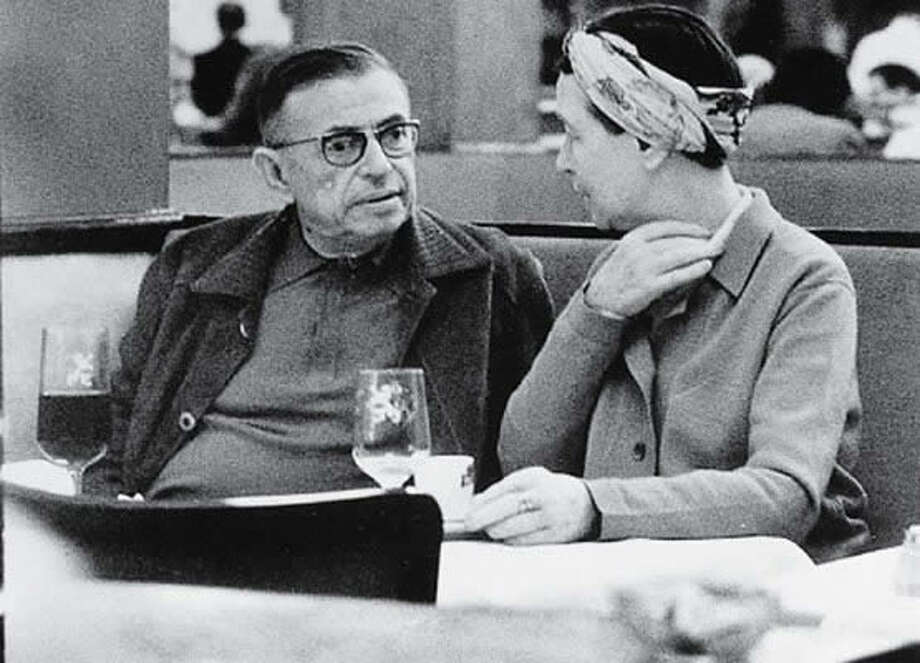 6 - Enjoy the coffeehouse setting, piling in with the crowd  … making eye contact ... feeling like an artist, entrepreneur, scientist or all three.   Photo: Jean Paul Sartre and Simone de Beauvoir where they could be found most often. Photo: Theredlist.fr