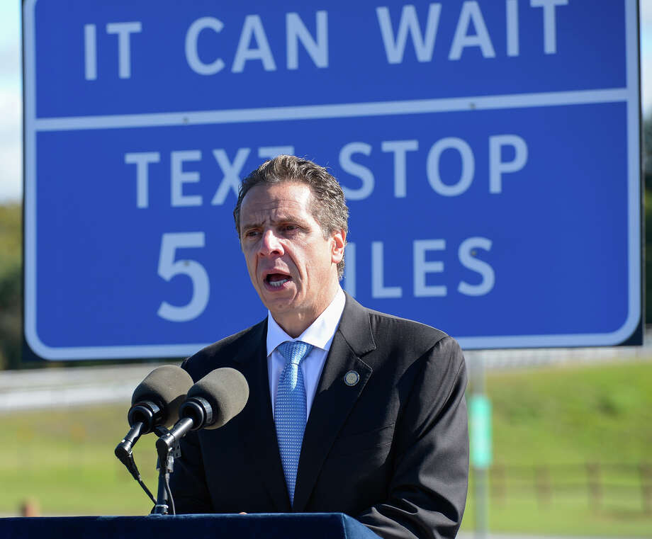 "In this photo provided by the New York Governor's Office, Gov. Andrew Cuomo speaks at a news conference at a highway rest stop Monday, Sept. 23, 2013, in New Baltimore, N.Y. Cuomo announced a new initiative Monday where New York's Thruway and other major state highways are getting nearly 300 new signs directing drivers to ""text stops"" as part of a campaign against distracted driving. (AP Photo/New York Governor's Office) ORG XMIT: NY111 / New York Governor's Office"