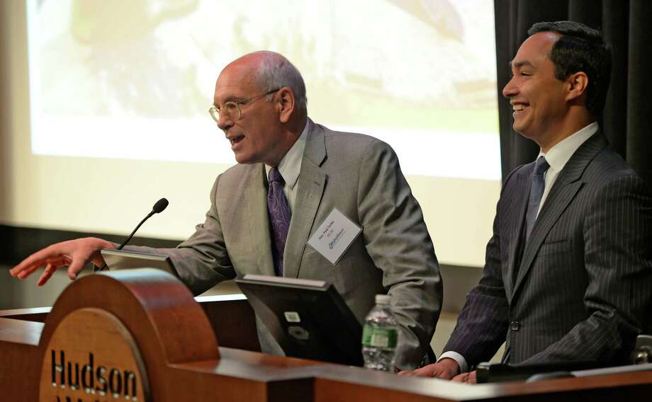 Congressman Paul Tonko, left is joined by Congressman Joaquin Castro, D-San Antonio, during a planning conference on waterways Monday morning, Sept. 23, 2013, at the Bulmer Telecommunications Building on the Hudson Valley Community College campus in Troy, N.Y.   (Skip Dickstein / Times Union) Photo: Skip Dickstein