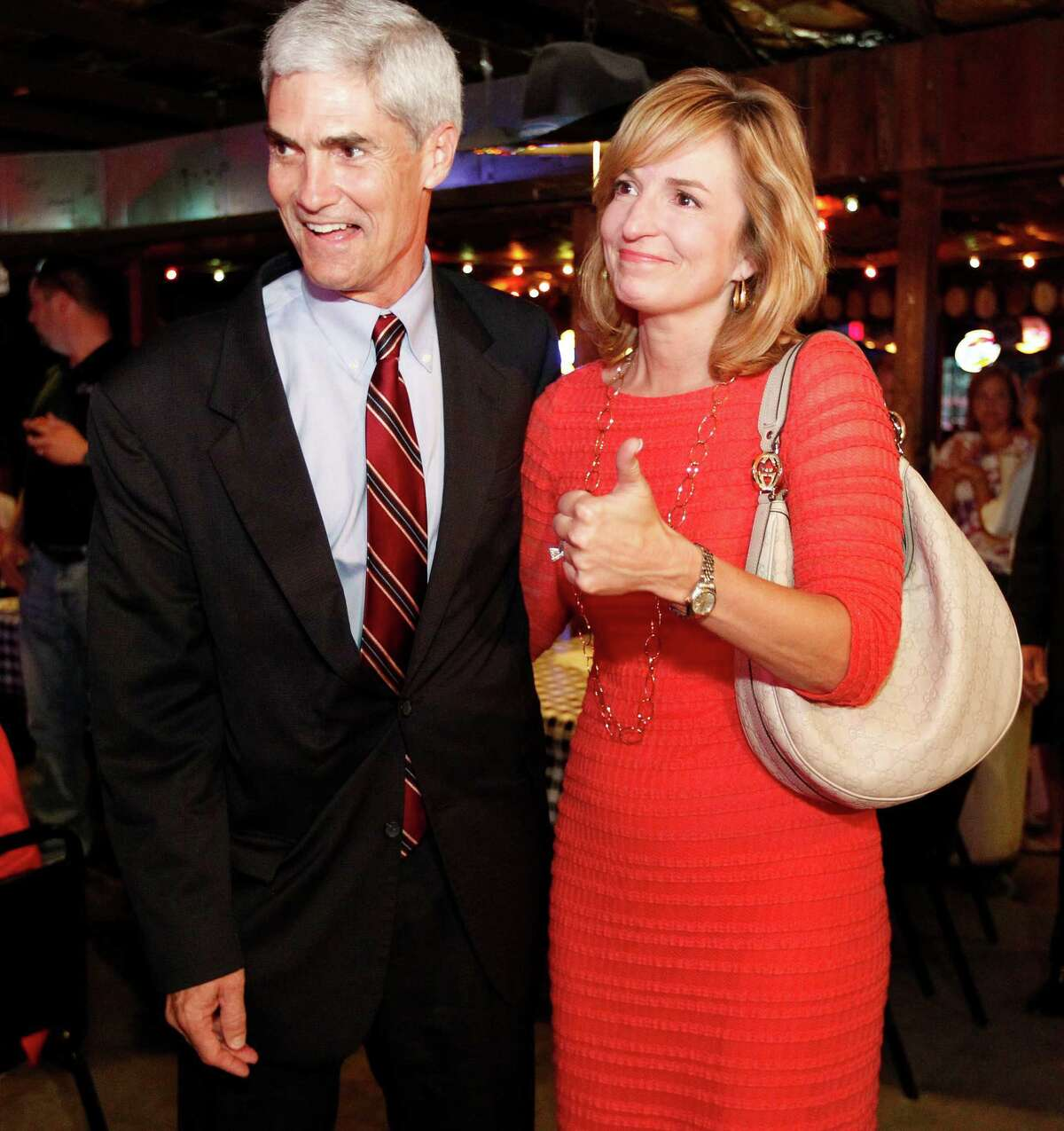 Republican candidate for Harris County District Attorney Mike Anderson and his wife Devon Anderson during Anderson's election watch party at Blanco's Bar & Grill Tuesday, May 29, 2012, in Houston. ( James Nielsen / Chronicle )