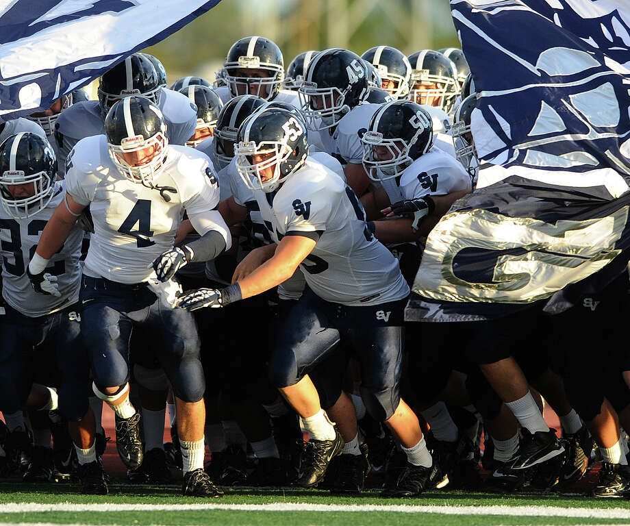 The Smithson Valley Rangers take the field for their game against Madison at Comalander Stadium on Thursday, Sept. 19, 2013. Photo: Billy Calzada, San Antonio Express-News / San Antonio Express-News
