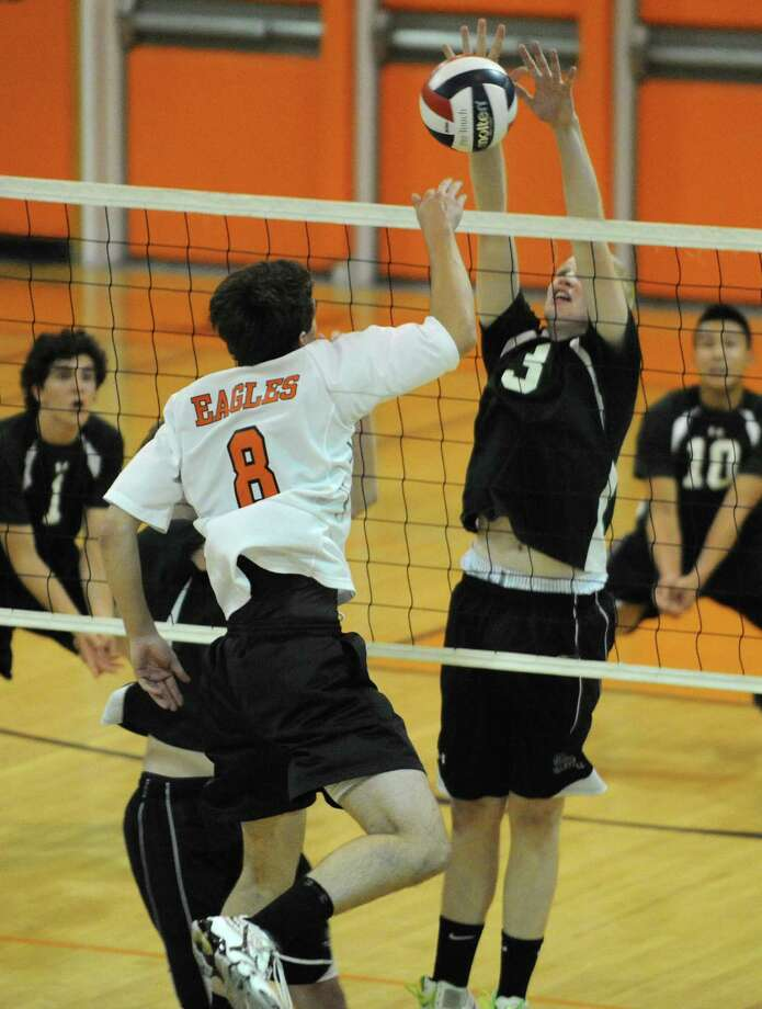 Shenendehowa's Kolin Krebs, right, blocks the ball hit over the net by Bethlehem's Aaron Carrk during a volleyball game on Monday, Sept. 23, 2013 in Delmar, N.Y.  (Lori Van Buren / Times Union) Photo: Lori Van Buren / 00023930A
