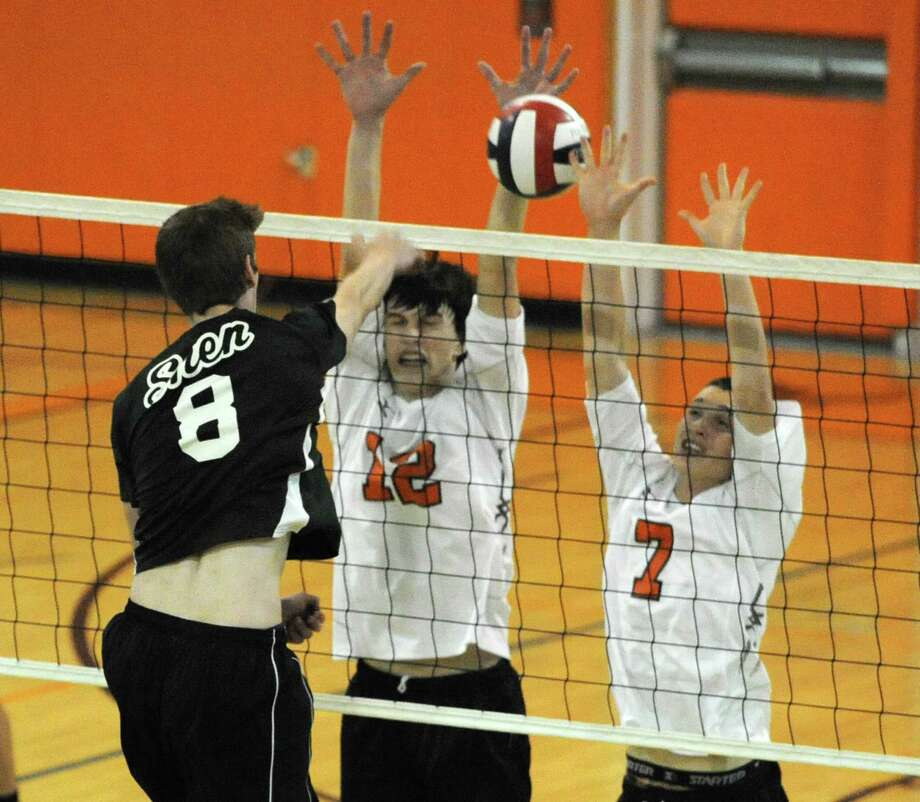 Shenendehowa's Scott Grable spikes the ball past Bethlehems's Kevin Mahar, center, and Kevin Cahill during a volleyball game on Monday, Sept. 23, 2013 in Delmar, N.Y.  (Lori Van Buren / Times Union) Photo: Lori Van Buren / 00023930A