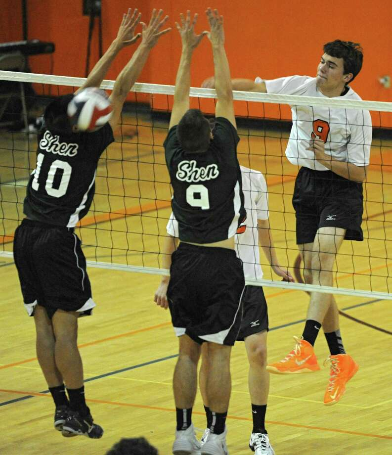 Bethlehem junior John Sica, right,  hits the ball past Shenendehowa's Logan Suguitan, left, and Evan Bittig during a volleyball game on Monday, Sept. 23, 2013 in Delmar, N.Y.  (Lori Van Buren / Times Union) Photo: Lori Van Buren / 00023930A