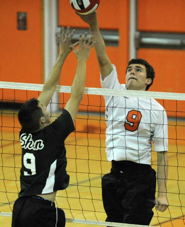 Bethlehem junior John Sica, right,  hits the ball over Shenendehowa's Evan Bittig during a volleyball game on Monday, Sept. 23, 2013 in Delmar, N.Y.  (Lori Van Buren / Times Union) Photo: Lori Van Buren / 00023930A
