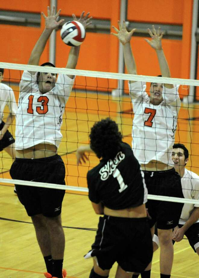 Shenendehowa's Theo Chiappone, center, tries to spike the ball past Bethlehems's Joe Foley, left, and Kevin Cahill during a volleyball game on Monday, Sept. 23, 2013 in Delmar, N.Y.  (Lori Van Buren / Times Union) Photo: Lori Van Buren / 00023930A