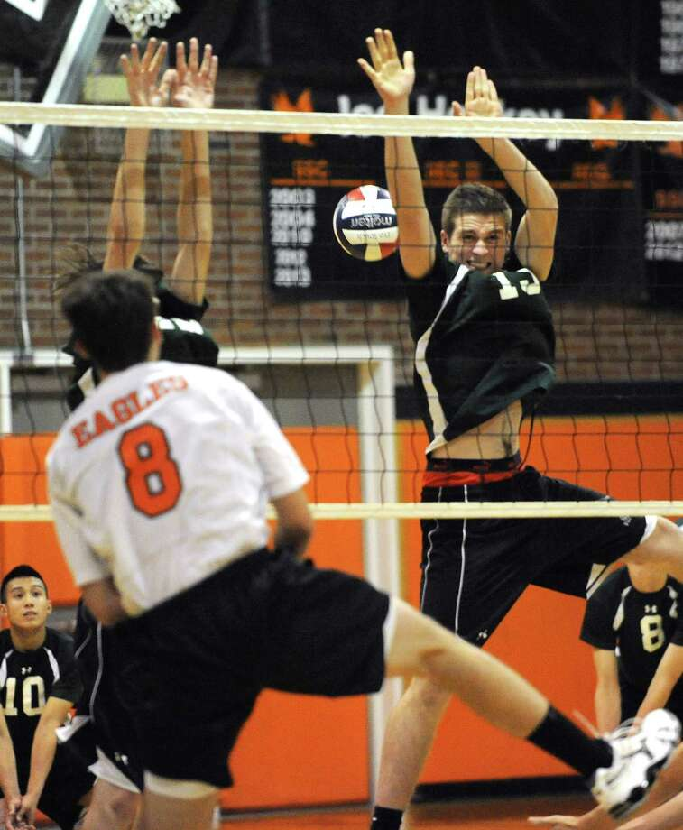 Bethlehem's Aaron Carrk, #8, hits the ball past Shenendehowa's Reid Hartl and Ostap Holovashchenko, right, during a volleyball game on Monday, Sept. 23, 2013 in Delmar, N.Y.  (Lori Van Buren / Times Union) Photo: Lori Van Buren / 00023930A