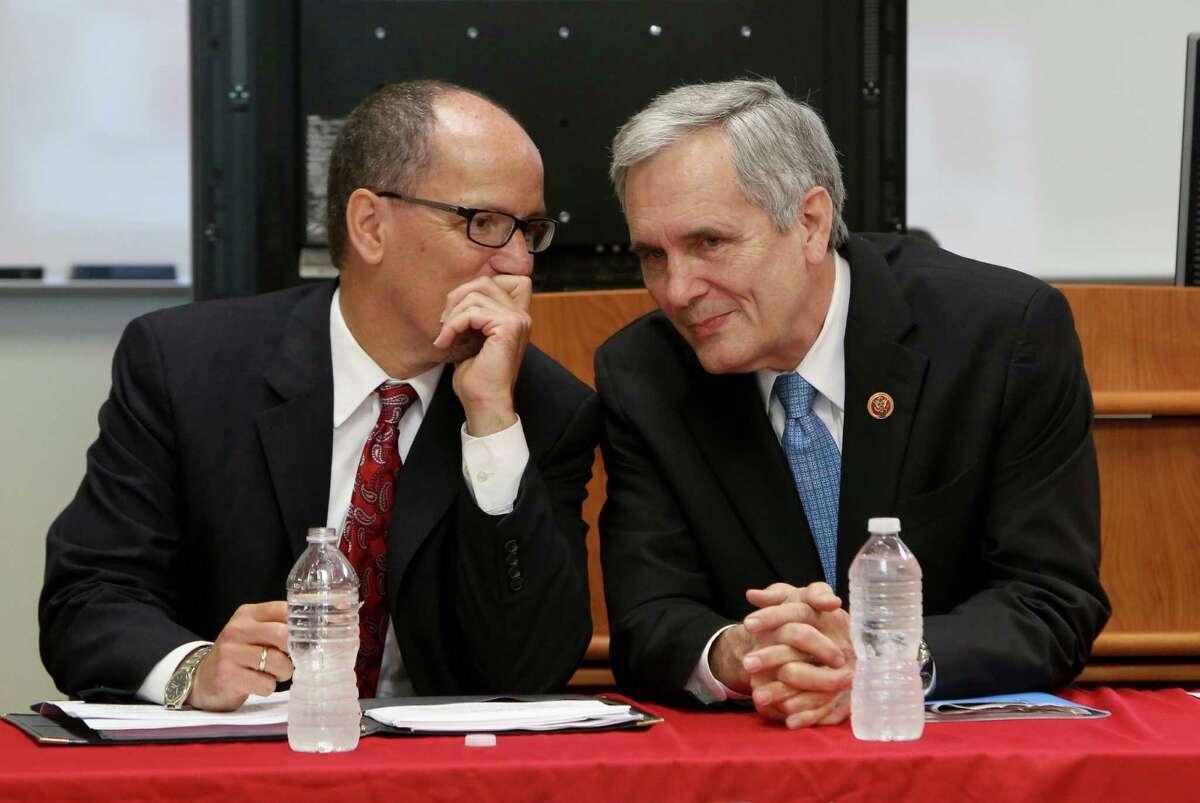 U.S. Secretary of Labor Thomas Perez talks with Congressman Lloyd Doggett before a forum at San Antonio College on the new health insurance laws a on Monday Sept. 23, 2013.