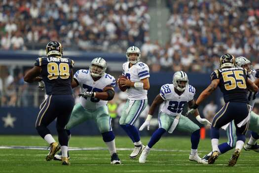ARLINGTON, TX - SEPTEMBER 22:  Tony Romo #9 of the Dallas Cowboys throws against the St. Louis Rams at AT&T Stadium on September 22, 2013 in Arlington, Texas. Photo: Ronald Martinez, Getty Images / 2013 Getty Images
