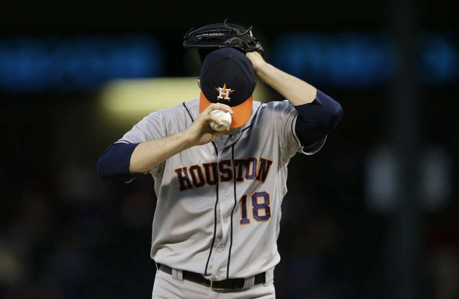 Sept. 23: Rangers 12, Astros 0  Astros pitcher Jordan Lyles adjusts his cap as he works against the Rangers during the first inning. Photo: Tony Gutierrez, Associated Press