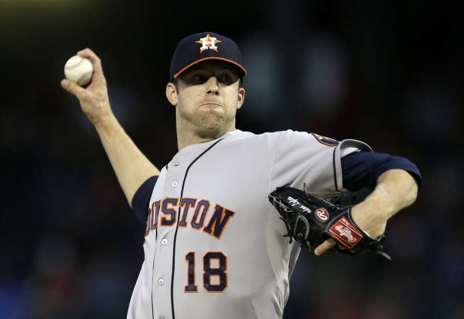 Astros pitcher Jordan Lyles delivers a throw to the Rangers. Photo: Tony Gutierrez, Associated Press
