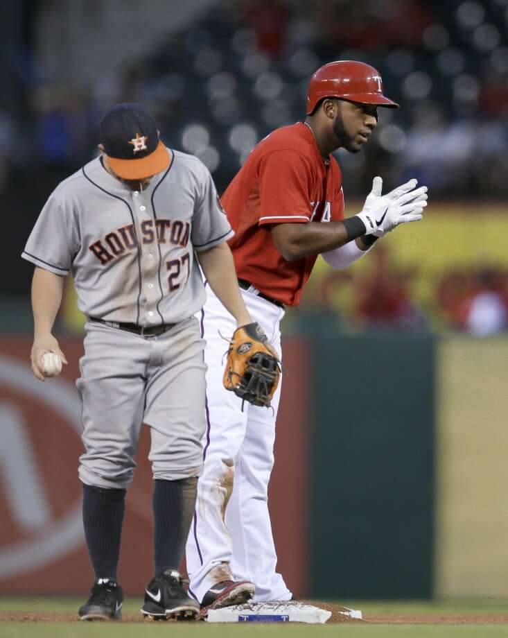 Elvis Andrus of the Rangers reacts after hitting a double, while Astros second baseman Jose Altuve looks on. Photo: Tony Gutierrez, Associated Press