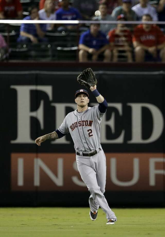 Brandon Barnes of the Astros makes a catch for an out against the Rangers. Photo: Tony Gutierrez, Associated Press