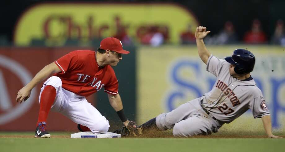 Astros second baseman Jose Altuve is unable to slide into second base on time against the Rangers. Photo: Tony Gutierrez, Associated Press