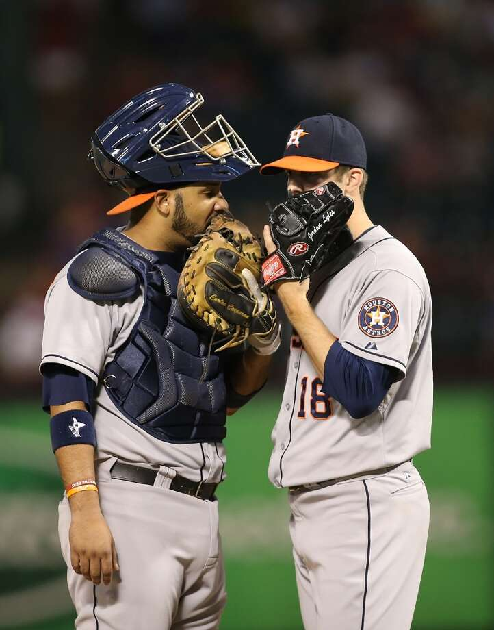 Astros catcher Carlos Corporan has a conversation with pitcher Jordan Lyles. Photo: Rick Yeatts, Getty Images