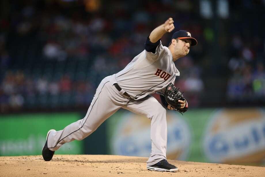 Astros pitcher Jordan Lyles delivers a throw to the Rangers. Photo: Rick Yeatts, Getty Images