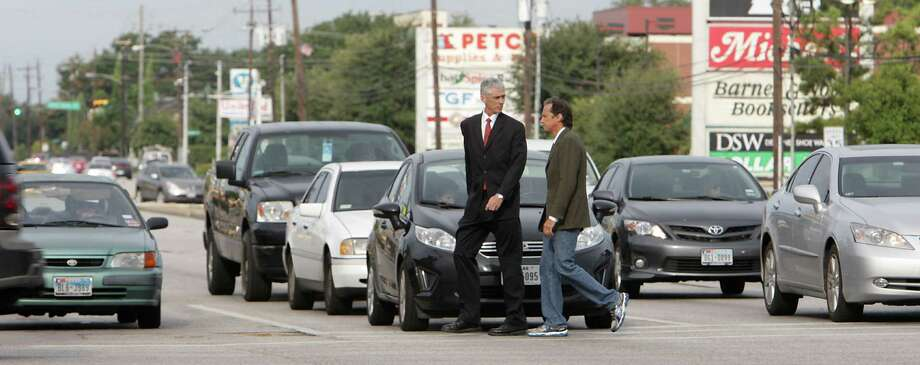 "The Art Guys, Michael Galbreth, left, and Jack Massing, at ""Intersection"" event #9 of ""12 Events"" - an 8-hour walk though the intersection of Westheimer at Hillcroft. Photo: James Nielsen, Staff / © 2013  Houston Chronicle"