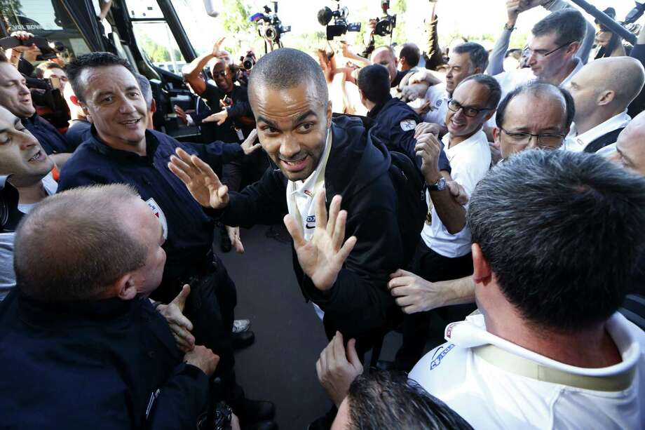 Spurs guard Tony Parker (center) and his French teammates are welcomed home at the airport in Paris a day after defeating Lithuania 80-66 for their first EuroBasket Championship. Photo: Thomas Samson / Getty Images