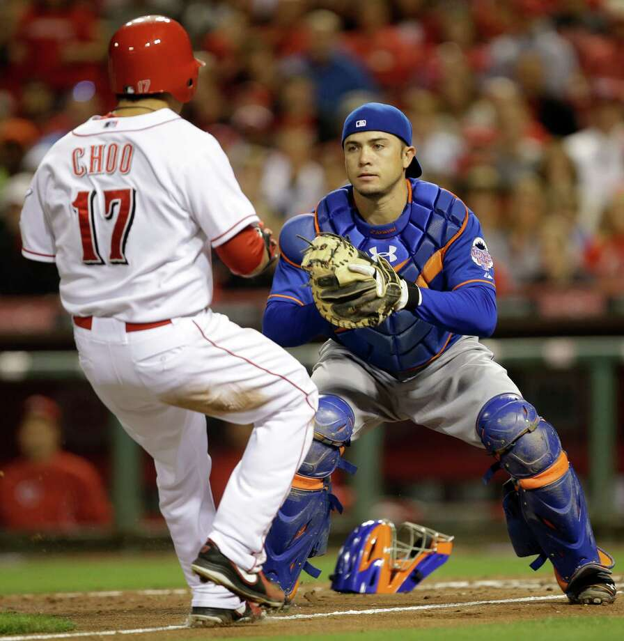 New York Mets catcher Travis d'Arnaud prepares to tag out Cincinnati Reds' Shin-Soo Choo (17) at home plate in the third inning of a baseball game, Monday, Sept. 23, 2013, in Cincinnati. (AP Photo/Al Behrman) ORG XMIT: CSA104 Photo: Al Behrman / AP