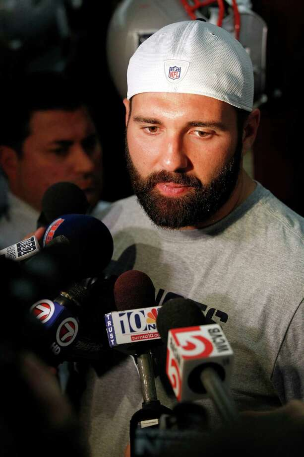 New England Patriots defensive end Rob Ninkovich speaks with the media in the locker room of Gillette Stadium in Foxborough, Mass., Tuesday, Sept. 10, 2013. The Patriots play the New York Jets on Thursday in Foxborough. (AP Photo/Stew Milne) ORG XMIT: MASM114 Photo: Stew Milne / FR56276 AP