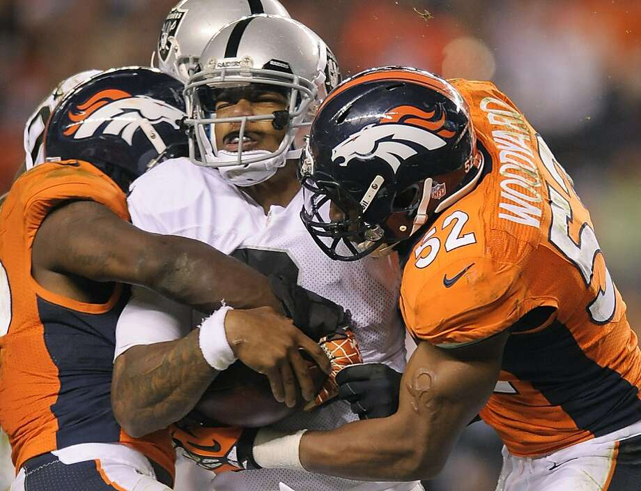 The Broncos' defense sacks Raiders quarterback Terrelle Pryor in the fourth quarter; he eventually left with a concussion. Photo: Jack Dempsey, Associated Press