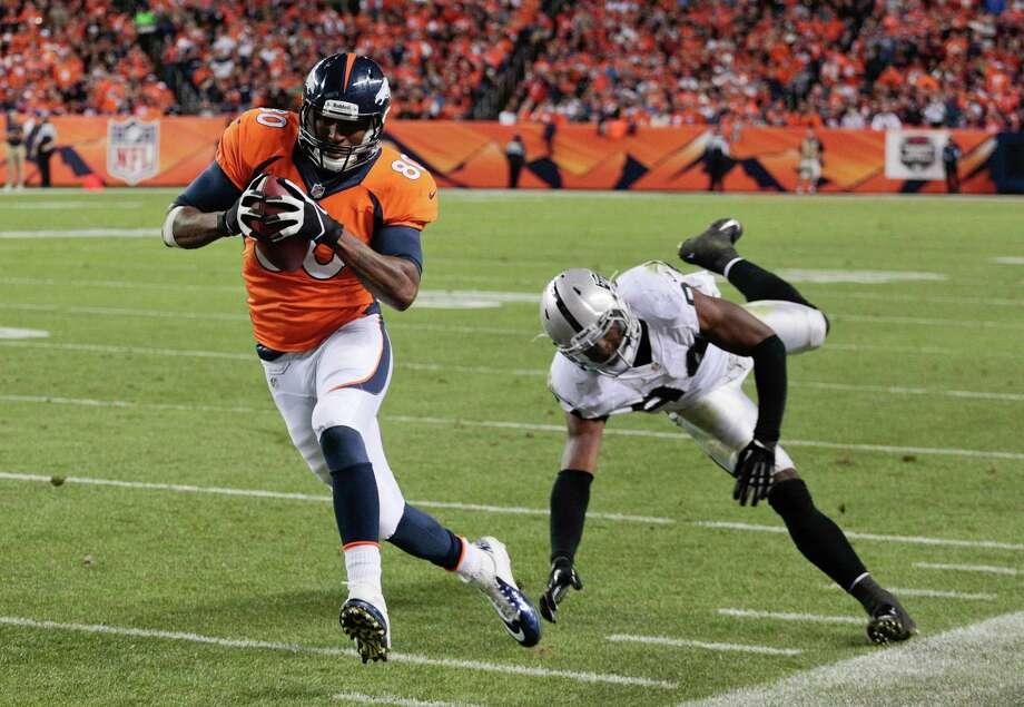 Denver tight end Julius Thomas beats Oakland linebacker Kevin Burnett (94) on a 13-yard touchdown pass - one of three by Peyton Manning on Monday. Photo: Joe Mahoney, FRE / FR170458 AP