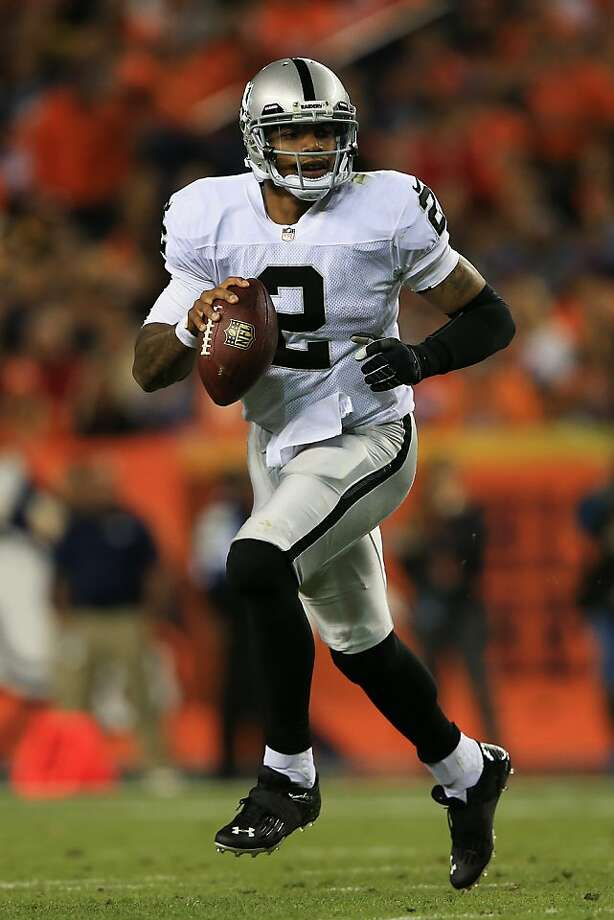 DENVER, CO - SEPTEMBER 23:  Terrelle Pryor #2 of the Oakland Raiders scrambles against the Denver Broncos in the first quarter at Sports Authority Field at Mile High on September 23, 2013 in Denver, Colorado.  (Photo by Doug Pensinger/Getty Images) Photo: Doug Pensinger, Getty Images
